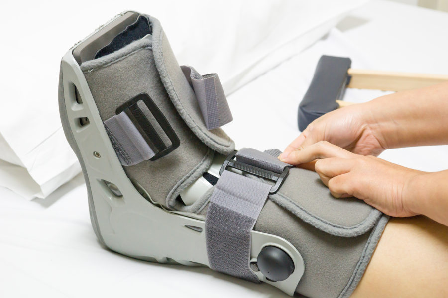 patient fastening straps on orthopaedic walking boot